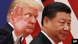 Predsjednici Donald Trump i Xi Jinping poslije razgovora u Pekingu 9. novembra, 2017.