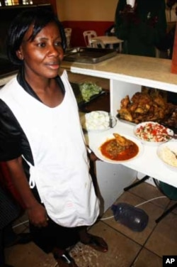 Nana Owusu, a cook at Uncle Ben's restaurant, is preparing to serve traditional African food to World Cup soccer supporters
