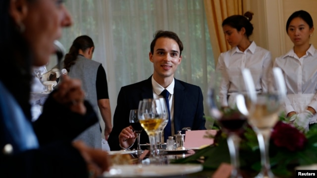 Guillaume, a French student takes part in a conversation role during a session on English dining during the Intensive Etiquette Courses at the Institut Villa Pierrefeu in Glion near Montreux, western Switzerland, October 22, 2013.