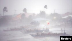Rough waters from Typhoon Rammasun toss fishing boats off the coast of the Philippines. (July 16, 2014.)