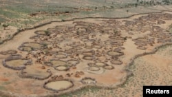FILE - An aerial view shows an arid, deserted traditional Turkana village in the northwestern Samburu district of northern Kenya, November 2012.