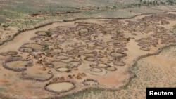 FILE - An aerial view shows an arid, deserted traditional Turkana village in the northwestern Samburu district of northern Kenya, November 2012.