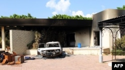 Burnt house, car inside U.S. embassy compound following overnight attack, Benghazi, Sept. 12, 2012.