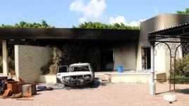 Remnants of a burned house and car inside gates the U.S. embassy compound, Benghazi, Libya, Sept. 12, 2012.