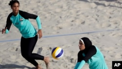 Egypt's Doaa Elghobashy, right, wears longer clothing and a hijab. This photo is from the 2016 Olympics in Brazil. (AP Photo/Marcio Jose Sanchez, File)