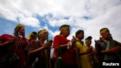 FILE - Members from the Taiwan Pingpu tribe protest during International Day of the World's Indigenous People near the presidential office in Taipei.