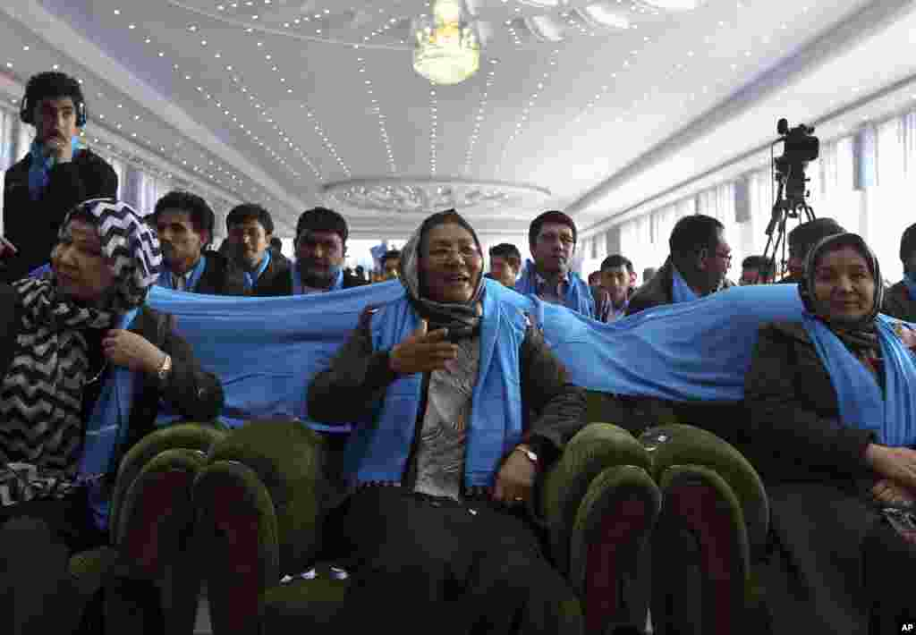 The deeply conservative, all-male crowd at Afghanistan's Kandahar stadium watch as vice-presidential candidate, Habiba Sarabi, in a headscarf stood up and reached for the microphone, Kabul, March 17, 2014.