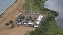 FILE - An aerial view of an oil exploration site in Bulisa district, approximately 244 km (152 miles) northwest of Kampala in this undated handout photo from Tullow Oil Uganda, received by Reuters July 4, 2012.