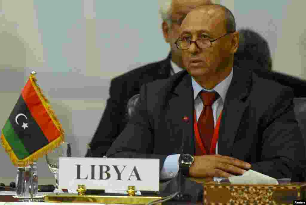 Libyan Foreign Minister Mohammed Abdel Aziz attends the Fourth Ministerial Meeting for the Neighboring Countries of Libya, which aims to address the latest developments in the security and political situation in Libya, in Cairo, Aug. 25, 2014.