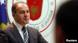 FILE - Kosovo's Foreign Minister Enver Hoxhaj speaks during a news conference, January 13, 2012.