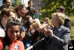 Democratic presidential candidate Hillary Clinton greets attendees during a campaign stop in Des Moines, Iowa, Sept. 29, 2016.