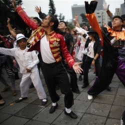 "Thousands perform in Mexico City in 2009 during an attempt to break the record for people dancing to Michael Jackson's ""Thriller"""
