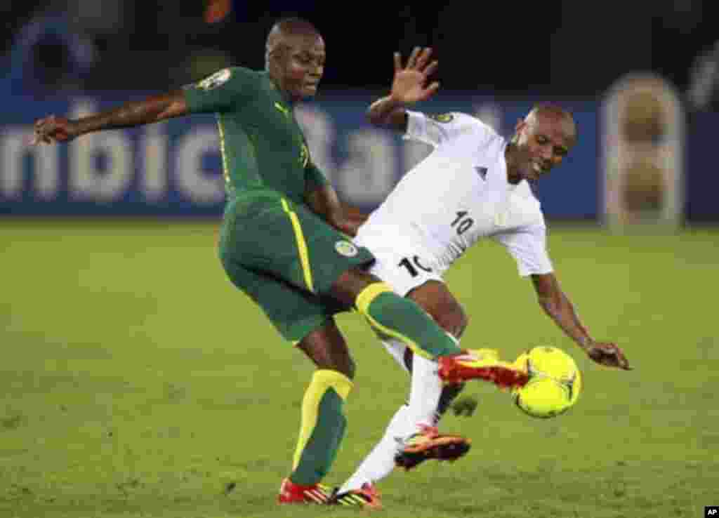 """Omar Daf of Senegal (L) challenges Ahmed Saad of Libya during their African Nations Cup Group A soccer match at Estadio de Bata """"Bata Stadium"""", in Bata January 29, 2012."""