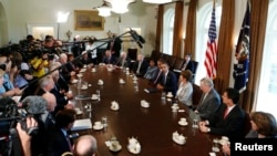 U.S. President Barack Obama (5th R) speaks at a meeting with bipartisan Congressional leaders in the Cabinet Room at the White House while discussing a military response to Syria, September 3, 2013.
