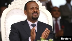 FILE - Ethiopia's newly elected prime minister, Abiy Ahmed, attends a rally during his visit to Ambo in the Oromiya region of Ethiopia, April 11, 2018. In his first U.S. visit, Abiy will focus on connecting with diaspora communities.