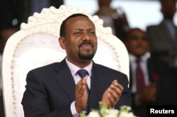 FILE - Ethiopian Prime Minister Abiy Ahmed attends a rally during his visit to Ambo in the Oromia region of Ethiopia, April 11, 2018. Tensions in Ethiopia's Somali region are considered among his biggest tests since assuming office earlier this year.