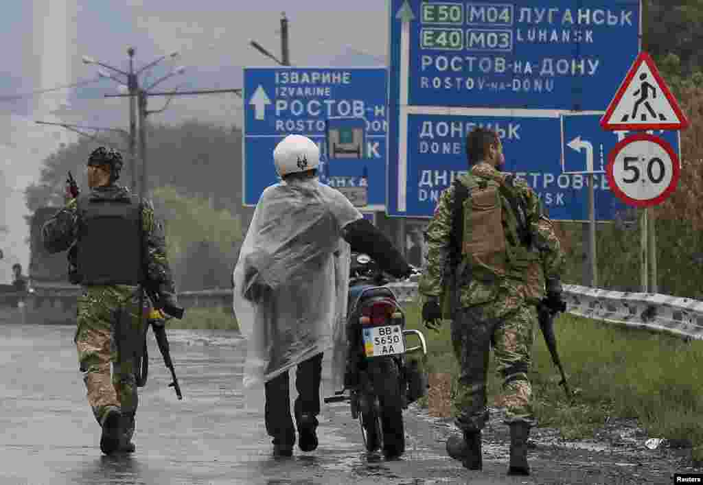 Ukrainian servicemen detain a local resident near a checkpoint in Debaltseve, Ukraine, Sept. 9, 2014.