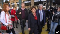 Candidate for the French Socialist Party presidential election Martine Aubry, center, arrives in Paris during the second round of the party's primary election to chose a candidate for the 2012 French presidential elections in Paris, October, 16, 2011.