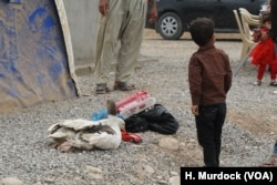 Families with almost nothing, but this boy's father managed to take out a couple of his geese and a toy in the Khazir Camp in the Kurdish region of northern Iraq, Oct. 28, 2016.