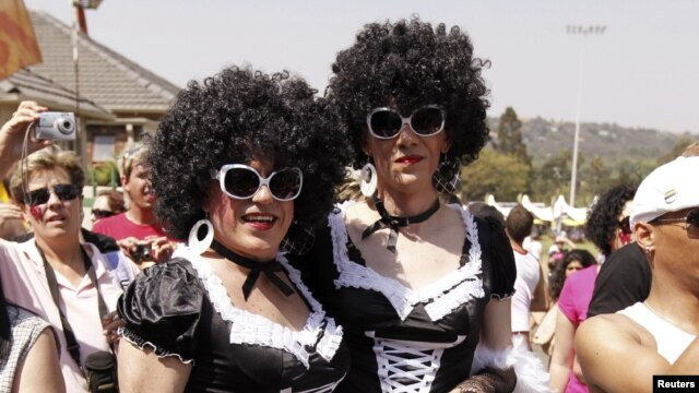 People take part in the Joburg Pride Parade in Johannesburg, South Africa, October 2, 2010.