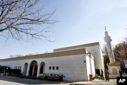 "FILE - The Dar Al-Hijrah Islamic Center is seen in Falls Church, Virginia, Nov. 8, 2009. ""Dar Al-Hijrah has a big role ahead of them to engage the youth,"" said one person at the center."