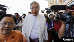 FILE - Htin Kyaw, nominated as Myanmar's National League for Democracy presidential candidate, arrives at Parliament in Naypyitaw, Feb. 1, 2016.