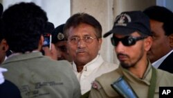 FILE - Pakistan's former president and military ruler Pervez Musharraf, center, is seen after appearing in court in Rawalpindi, April 17, 2013.