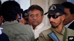 Pakistan's former president and military ruler Pervez Musharraf, center, leaves after appearing in court in Rawalpindi, Pakistan, April 17, 2013.