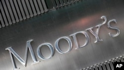 FILE - This Aug. 2010 file photo shows a sign for Moody's Corp. in New York. Concerns are building from Washington to Wall Street about the trillions of dollars in debt that U.S. businesses have racked up.