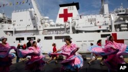 "Venezuelan dancers welcome the arrival of Chinese navy hospital ship "" The Peace Ark"" docked at the port in la Guaira, Venezuela, Saturday, Sept. 22, 2018. (AP)"
