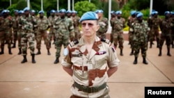 FILE - U.N. peacekeepers mark the start of the 12,000-strong U.N. peacekeeping mission, called MINUSMA, in Mali, July 1, 2013. Another 2,500 peacekeeping troops will be sent to Mali in light of recent violence.