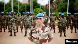FILE - U.N. peacekeepers mark the start of the 12,000-strong U.N. peacekeeping mission in Mali, July 1, 2013.