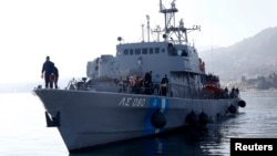 Greek Coast Guard vessel Agios Efstratios, carrying refugees and migrants following a rescue operation, approaches the port of the Greek island of Lesbos, Feb. 8, 2016. Picture taken Feb. 8, 2016.