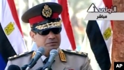 In this image taken from Egypt State TV, Egyptian army chief Abdel Fattah el-Sissi delivers a speech in Cairo, July 24, 2013.