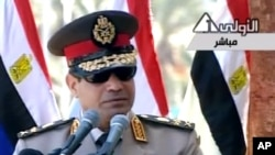 FILE- In this image taken from Egypt State TV, Egyptian army chief Abdel Fattah el-Sissi delivers a speech in Cairo, July 24, 2013.