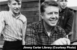Jimmy Carter and two of his sons at the family farm. Jimmy and Rosalynn went on to have a daughter as well.