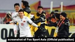 Đội tuyển U23 Việt Nam ăn mừng chiến thắng trước Qatar hôm 23/1.