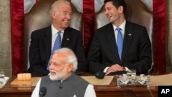 Vice President Joe Biden and House Speaker Paul Ryan laugh as Indian Prime Minister Narendra Modi addresses a joint meeting of Congress on Capitol Hill in Washington, June 8, 2016.