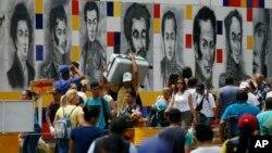 Venezuelans return to their country through the San Antonio del Tachira, Venezuela, crossing after shopping in Cucuta, Colombia, Feb. 8, 2019.