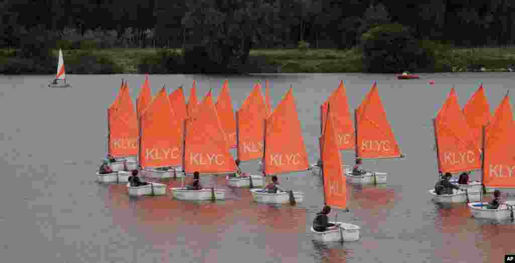 Children learn to sail on the Galgenweel lake in Antwerp, Belgium.