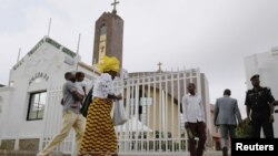 Worshipers arrive at Holy Trinity Catholic Church in Nigeria's capital, Abuja, June 24, 2012.