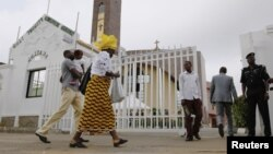 Worshipers arrive at Holy Trinity Catholic Church in Nigeria's capital Abuja, June 24, 2012.