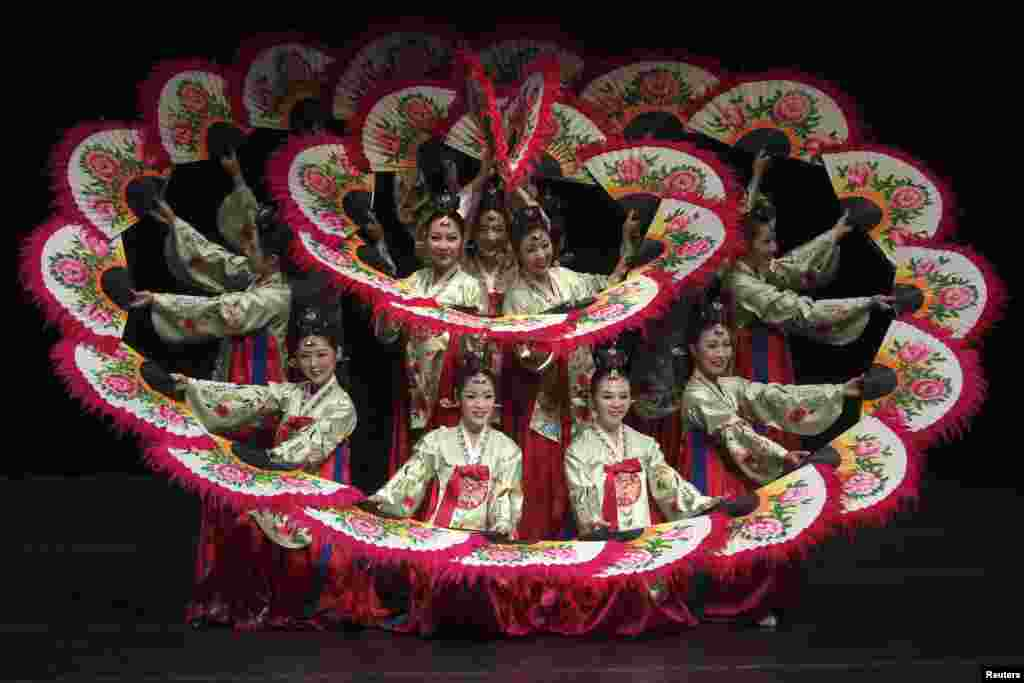"Members of the Korean National Gugak Center perform a traditional Korean dance during the show entitled ""The Movements of Korea"" at the Al Hussein Cultural Center in Amman, Jordan, Oct. 10, 2013."