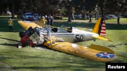 An airplane flown by actor Harrison Ford sits on the ground after crash-landing at Penmar Golf Course in Venice, California, March 5, 2015.