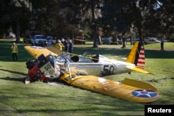 An airplane — reportedly flown by actor Harrison Ford — sits on the ground after crash-landing at Penmar Golf Course in Venice, California, March 5, 2015.