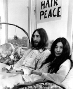"John Lennon and Yoko Ono holding a ""bed-in"" in Amsterdam on March 25, 1969. They were protesting the US war in Vietnam."