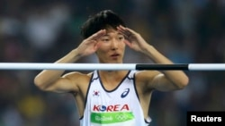Woo Sang-hyuk of South Korea reacts in the men's high jump qualifying round during the Olympic Games in Rio de Janeiro, Brazil, Aug. 14, 2016.