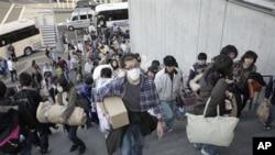 Evacuees from Futaba, a town near the tsunami-crippled Fukushima Dai-ichi nuclear plant in Fukushima Prefecture, arrive their new evacuation shelter at Saitama Super Arena in Saitama, near Tokyo, Japan, March 19, 2011