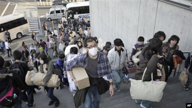 Evacuees from Futaba, a town near the tsunami-crippled Fukushima Dai-ichi nuclear plant in Fukushima Prefecture, arrive their new evacuation shelter at Saitama Super Arena in Saitama, near Tokyo, Japan, March 19, 2011