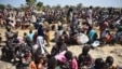 FILE - A photo of some of the thousands of people who flocked into Leer town, South Sudan, to receive food from the International Committee of the Red Cross, Dec. 15, 2015.